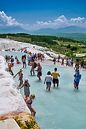 Tourists bathing in the travatine pools oand thermal waters of Pamukkale. Turkey .<br /> <br /> If you prefer to buy from our ALAMY PHOTO LIBRARY  Collection visit : https://www.alamy.com/portfolio/paul-williams-funkystock/pamukkale-hierapolis-turkey.html<br /> <br /> Visit our TURKEY PHOTO COLLECTIONS for more photos to download or buy as wall art prints https://funkystock.photoshelter.com/gallery-collection/3f-Pictures-of-Turkey-Turkey-Photos-Images-Fotos/C0000U.hJWkZxAbg