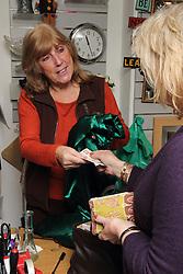 Volunteer and customer at Mysight charity shop.