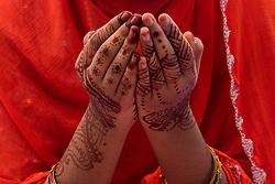 June 26, 2017 - Kolkata, India - A Muslim girl in deep prayers with hands painted with henna tattoos during the Eid prayers Of Eid al-fitr in Kolkata (Calcutta). (Credit Image: © Sushavan Nandy/NurPhoto via ZUMA Press)