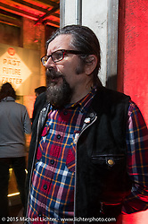 """Low Ride Magazine's editor Giuseppe Roncen at the """"Live the Night Faster"""" party hosted by Yamaha at the Officine del Volo during EICMA, the largest international motorcycle exhibition in the world. Milan, Italy. November 17, 2015.  Photography ©2015 Michael Lichter."""
