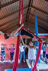 Aerial dancer and yoga practitioner Ana Prada, who has worked with such companies as Cirque du Soleil and Antigravity, demonstrates an aerial pose during her weekend workshop Aerial Silks, Vayu Aerial Yoga and Gyrokinesis® with Ana Prada at Point Wellness Spa.   St. Thomas, VI.  12 June 2015.  © Aisha-Zakiya Boyd