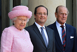 Buckingham Palace has announced Prince Philip, The Duke of Edinburgh, has passed away age 99 - FILE - Queen Elizabeth II, Duke of Edinburgh and French President Francois Hollande arrives at the Elysee palace in Paris, France, June 5, 2014. The Queen is on a 2-day state visit ahead of the ceremonies marking the D-Day 70th Anniversary in Normandy. Photo by Christian Liewig/ABACAPRESS.COM