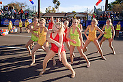 03 JANUARY 2009 -- PHOENIX, AZ: Lexie Melton (CQ) 13, (center in red) and other members of the Desert West Dance Academy in Buckeye perform in the annual Ft. McDowell Fiesta Bowl parade through Phoenix, AZ. More than 150,000 spectators line the parade routes which starts in north Phoenix and winds down Central Ave and 7th Street before ending in central Phoenix. More than 100 units march in the parade.  PHOTO BY JACK KURTZ