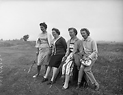 23/06/1959<br /> 06/23/1959<br /> 23 June 1959 <br /> Irish Amateur Close Golf Championships at Portmarnock, Dublin. Watching her husband play in the championships was Mrs. O'Sullivan (second from left), wife of the President of the Golfing Union of Ireland Dr. William O'Sullivan of Killarney Golf Club, with her friends Mrs. R. Godsil, (left) Malahide; Miss Joan Purcell (second from right) niece of Dr. O'Sullivan and a friend from Berlin, Mrs Willy Ehmer.