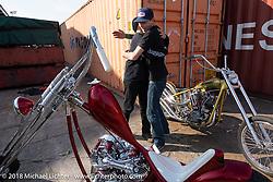 Ryan Grossman helping Hawke Lawshe to start his custom Knuckle at the docks on setup day for the 27th Annual Mooneyes Yokohama Hot Rod Custom Show 2018. Yokohama, Japan. Saturday, December 1, 2018. Photography ©2018 Michael Lichter.