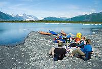 Taking a lunch break from a kayak trip at Bear Glacier, Kenai Fjords National Park, Alaska