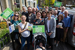 London, UK. 22 May, 2019. Caroline Lucas, Green Party MP for Brighton Pavilion, campaigns for the European elections in East Dulwich and Peckham with Scott Ainslie and Gulnar Hasnain, who top the Green Party list in London, and Helen Pickering of Mums for Lungs.