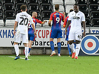 Football - 2018 / 2019 EFL Carabao Cup (League) Cup - Swansea City vs. Crystal Palace<br /> <br /> Tyler Reid, of Swansea City looks away as Alexander Sorloth, of Crystal Palace celebrates scoring his team's first goal, at Liberty Stadium.<br /> <br /> COLORSPORT/WINSTON BYNORTH