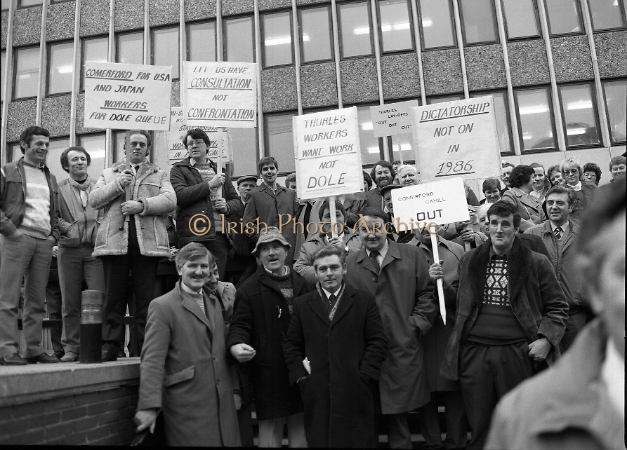 Thurles Sugar Workers Protest..1986..16.01.1986..01.16.1986..16th January 1986..After a rationionalisation plan was invoked the Irish Sugar Company which had already closed the sugar factory at Tuam now turned its attention to the factory at Thurles. The soon to be affected workers staged a protest against the cuts at the headquarters of The Sugar Company at Earlsfort Terrace,Dublin..The workers were supported by trade union officials and had much cross party support from Dail Eireann and The Seanad. Included among the protestors were,.Hugh Byrne TD,Sean Treacy TD, Senator Des Hanifin,Sean Byrne TD,Senator Mick Smith,.Maura Scully, Chairperson,Thurles,UDC, Cllr John O'Connor,David Moloney TD, Cllr Tom Condon, Pat Rabbitte, National General Secretary.IT&GWU,John Ryan TD,Leas Ceann Comhairle of the Dail,Senator Michael Ferris,Duputy Leader of the Senate,Labour spokesman on agriculture,Ned Brennan,Cllr Harry Byrne and Michael Kennedy TD...Photograph of some of the protest placards being displayed by the Thurles and Tuam sugar factory workers.