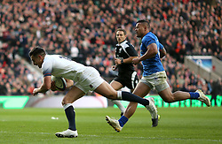 England's Alex Lozowski scores his side's second try of the game during the Autumn International at Twickenham Stadium, London.