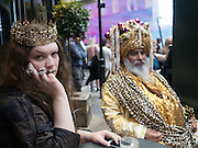 Daniel Lismore and Kala, Watching the scene during Fashion week. Outside the Brewer St. car-park. Soho, London.  20 September 2016