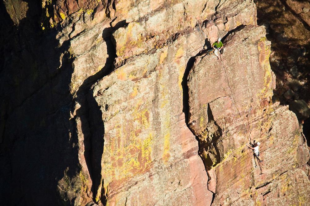 Two climbers on the The Bastille, Eldorado Canyon State Park, Colorado.