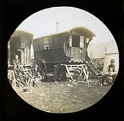 Magic lantern slide portrait of fairground travelling gypsies and caravans, UK circa 1900