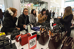 © Licensed to London News Pictures. 26/12/2016. Customers in the ladies handbag department of Selfridges store in Oxford Street for the start of the stores Boxing Day sales. London, UK. Photo credit: Ray Tang/LNP
