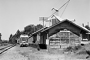 Y-680604-B03.  Aurora Train Depot. Built in 1870 as a passenger station by Southern Pacific, the Aurora Depot is today an antiques and lamps store. The building was moved about 100 feet from the railroad and now exists at 21651 Main Street. Aurora, Oregon. June 4, 1968