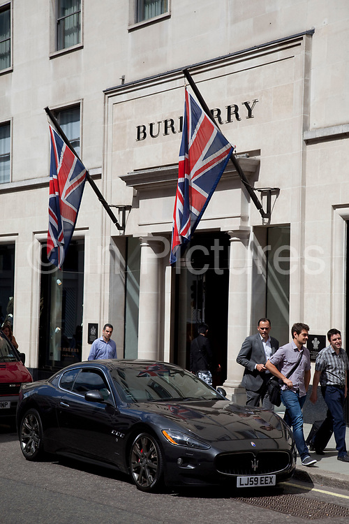 """Maserati outside Burberry. Exclusive shops on New Bond Street, Mayfair, central London. It is one of the principal streets in the West End shopping district and is more upmarket. It has been a fashionable shopping street since the 18th century. Technically """"Bond Street"""" does not exist: The southern section is known as Old Bond Street, and the northern section, which is rather more than half the total length, is known as New Bond Street. The rich and wealthy shop here mostly for high end fashion and jewellery."""
