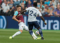 Football - 2017 / 2018 Premier League - West Ham United vs Tottenham Hotspur<br /> <br /> Aaron Cresswell (West Ham United)  and Serge Aurier (Tottenham FC) compete for the loose ball at the London Stadium<br /> <br /> COLORSPORT/DANIEL BEARHAM