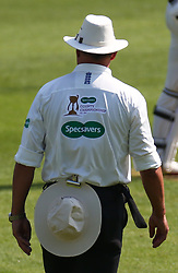 April 20, 2018 - London, Greater London, United Kingdom - Umpire showing Advert on the back his shirt.during Specsavers County Championship - Division One, day one match between Surrey CCC and Hampshire CCC at Kia Oval, London, England on 20 April 2018. (Credit Image: © Kieran Galvin/NurPhoto via ZUMA Press)