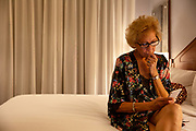 Senior Woman on cell Phone Contemplating