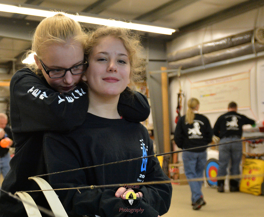 "NORTH YARMOUTH, Maine,  -- 1/17/16 --  Kendra Ryder, 13, of Winterport, Maine, leans on Jacqueline Filasky, 16 of Woodbridge, Connecticut at Lakeside Archery in North Yarmouth on Sunday during the 10th Fire & Ice Burn Survivors Winter Camp put on by the Portland Firefighters Children's Burn Foundation. Portland area firefighters served as camp counselors - bringing the teens to the Camden Snow Bowl, Lakeside Archery and several other regional locations for group events and personal support activities.  <br /> Fire and Ice started in 2005 with four burn victims and nine counselors. This year there were 23 youth campers from all over New England participating in a three-day event. Campers came together by doing series of activities in which they bond and become close friends. ""These kids have all been through similar traumatic expereinces,"" said Portland Firefighter and counselor Sheldon Gregiore.  <br /> A first-time youth camper (whose identity is being kept anonymous) said, ""All I can say is, burned people rule!""  <br /> For more information, register or donate visit: http://www.maineburnsurvivors.org. <br /> Photo © Roger S. Duncan 2016 for The Forecaster."