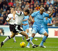 Photo: Ed Godden.<br />Coventry City v Derby County. Coca Cola Championship. 11/11/2006. Coventry's Leon McKenzie (R) challenges Paul Boertien.