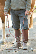 Detail of Gaucho holding rope, Estancia Huechahue, Patagonia, Argentina, South America