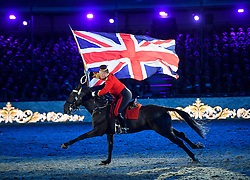 © Licensed to London News Pictures. 15/05/2016. Windsor, UK.  The Union flag being ridden through the arena. An evening event held at the Royal Windsor Horse show to celebrate the 90th birthday of HRH Queen Elizabeth II. Acts from arounds the world have been invited to perform at the evening event, set in the grounds of Windsor Castle. Photo credit: Ben Cawthra/LNP