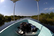 Photographer's equipment in boat on creek at Crooked Tree.