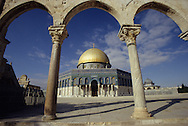 Geometrically framed travel photograph of the Dome of the rock in Jerusalem.