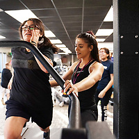In Gallup, trainer Taea Hill, 20, left, coaches Dani Jimenez, 17, while she warms up. The Miyamura High School softball team worked on their speed techniques for the upcoming season at the Rehoboth McKinley Christian Health center on Tuesday.