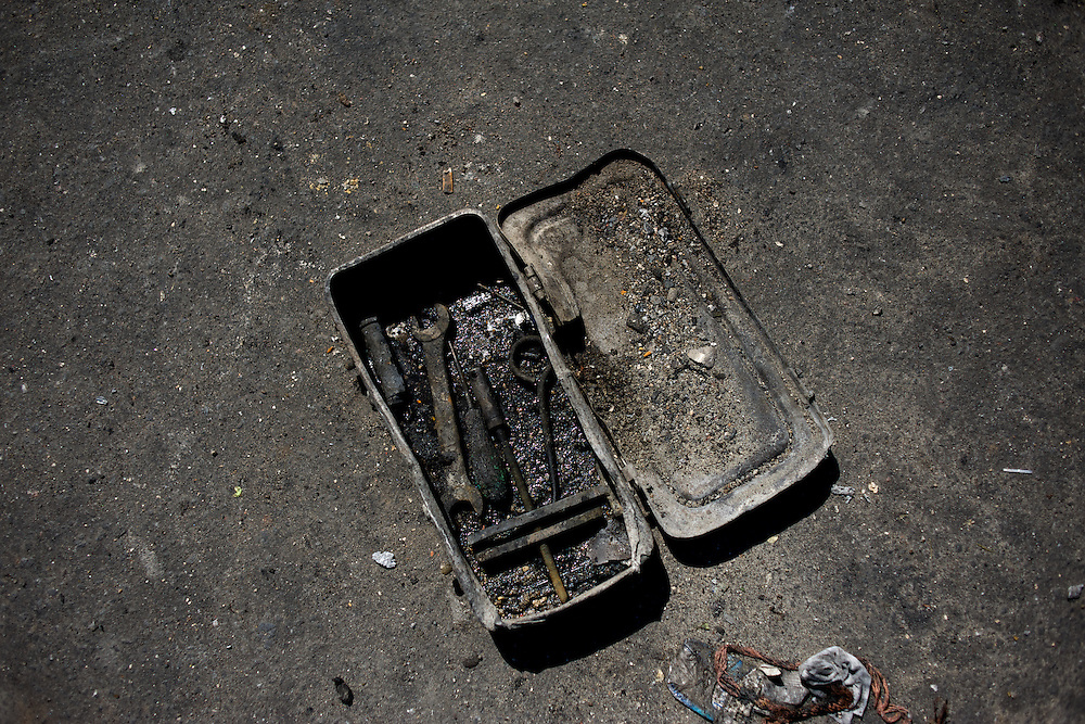 A charred tool box is seen on the ground beside a military tank, set alight hours after deadly clashes between separatists armed groups and the Ukrainian Army over the control of key buildings in the city.