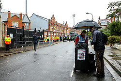Fans arrive at a wet Craven Cottage for the Premier League fixture between Fulham and Burnley - Mandatory by-line: Robbie Stephenson/JMP - 26/08/2018 - FOOTBALL - Craven Cottage - Fulham, England - Fulham v Burnley - Premier League