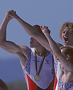 Barcelona, SPAIN. Gold Medalist, GBR M2+, Bow Jonny SEARLE and Greg SEARLE with cox, Gary HERBERT.  Celebrate on the awards dock. 1992 Olympic Rowing Regatta Lake Banyoles, Catalonia [Mandatory Credit Peter Spurrier/ Intersport Images] Last time Men's coxed pair raced at the Olympics