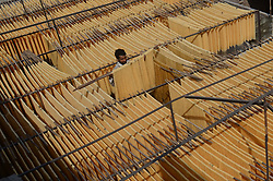 June 15, 2017 - Lahore, Punjab, Pakistan - Pakistani worker spreading the thin vermicelli (Sevaian) for drying at a factory in Lahore.  Muslims all over the world make a traditional sweet dish 'sheerkhurma' popular during the Islamic holy month of Ramadan. (Credit Image: © Rana Sajid Hussain/Pacific Press via ZUMA Wire)