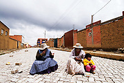 El Alto. Food for work. Women having a lunch in a break from building a road.