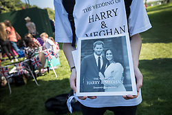 © Licensed to London News Pictures. 19/05/2018. Windsor, UK. A man sells souvenir programmes on the Long Walk before the arrival of The Duke and Duchess of Sussex after the marriage ceremony at Windsor Castle. Photo credit: Peter Macdiarmid/LNP