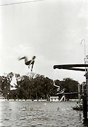 swimming pool with person salto jumping from diving board 1920s