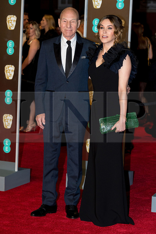 © Licensed to London News Pictures. 18/02/2018. SIR PATRICK STEWART and SUNNY OZELL arrives on the red carpet for the EE British Academy Film Awards 2018, held at the Royal Albert Hall, London, UK. Photo credit: Ray Tang/LNP