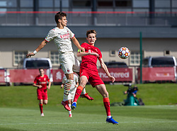 LIVERPOOL, ENGLAND - Wednesday, September 15, 2021: AC Milan's Milos Kerkez (L) and Liverpool's captain Tyler Morton during the UEFA Youth League Group B Matchday 1 game between Liverpool FC Under19's and AC Milan Under 19's at the Liverpool Academy. Liverpool won 1-0. (Pic by David Rawcliffe/Propaganda)
