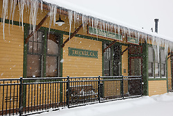 """""""Snowy Truckee, CA Visitor Center"""" - Photograph of a snowy and icicle covered Visitor Center in Historic Downtown Truckee, California."""