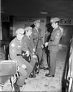 05/01/1972.01/05/1972.05 January 1972.Troops return from Cyprus to Dublin.  L-R: Gunner Robert English C.D.A. Spike Island; Private Michael Finn, 1st Feild C.O.E., Cork; Cpl. Thomas Rochford, 1st Field C.O.E. Cork and Cpl. Maurice Lordan, Records Office, Collins Barracks, Cork.