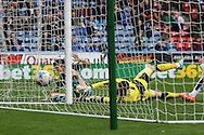 Fernando Forestieri of Sheffield Wednesday gets to the ball before Huddersfield Town Goalkeeper Jed Steer and scores his teams first goal. Skybet football league Championship match, Huddersfield Town v Sheffield Wednesday at the John Smith's Stadium in Huddersfield, Yorkshire on Saturday 2nd April 2016.<br /> pic by Chris Stading, Andrew Orchard sports photography.