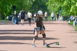 © Licensed to London News Pictures 27/05/2021. Greenwich, UK. A teenage with her skateboard in Greenwich Park, London on a hot sunny weather day today.  Photo credit:Grant Falvey/LNP