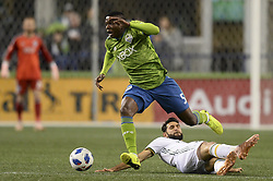 November 8, 2018 - Seattle, Washington, U.S - Portland's DIEGO VALERI (8) tries to slide tackle NOUHOU (5) of the Seattle Sounders. The Portland Timbers visited the Seattle Sounders in a MLS Western Conference semi-final match at Century Link Field in Seattle, WA. (Credit Image: © Jeff Halstead/ZUMA Wire)