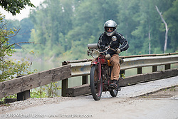 Doug Jones riding his 1914 Indian Model 260 Standard over the treacherous to motorcycles, wooden Wabash Cannonball Bridge in St. Francisville, Illinois during the Motorcycle Cannonball Race of the Century. Day-4 ride from Bloomington, IN to Cape Girardeau, MO. USA. Wednesday September 14, 2016. Photography ©2016 Michael Lichter.