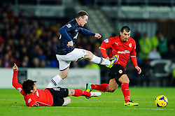 Man Utd Forward Wayne Rooney (ENG) is tackled by Cardiff Midfielder Kim Bo-Kyung (KOR) during the second half of the match - Photo mandatory by-line: Rogan Thomson/JMP - Tel: Mobile: 07966 386802 - 24/11/2013 - SPORT - FOOTBALL - Cardiff City Stadium - Cardiff City v Manchester United - Barclays Premier League.