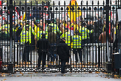 Whitehall, London, November 5th 2015. Pro Sisi demonstrators and counter protesters from UK Egyptian and human rights groups shout each other down outside Downing Street ahead of Egypt's President Abdel Fatah al-Sisi visiting Prime Minister David Cameron at No. 10. PICTURED: Police push back pro-Morsi supporters outside the gates of Downing Street.