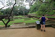 Woman tourist in the water gardens of Sigiriya rock palace, Central Province, Sri Lanka, Asia