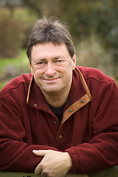 Alan Titchmarsh with packets of bulbs