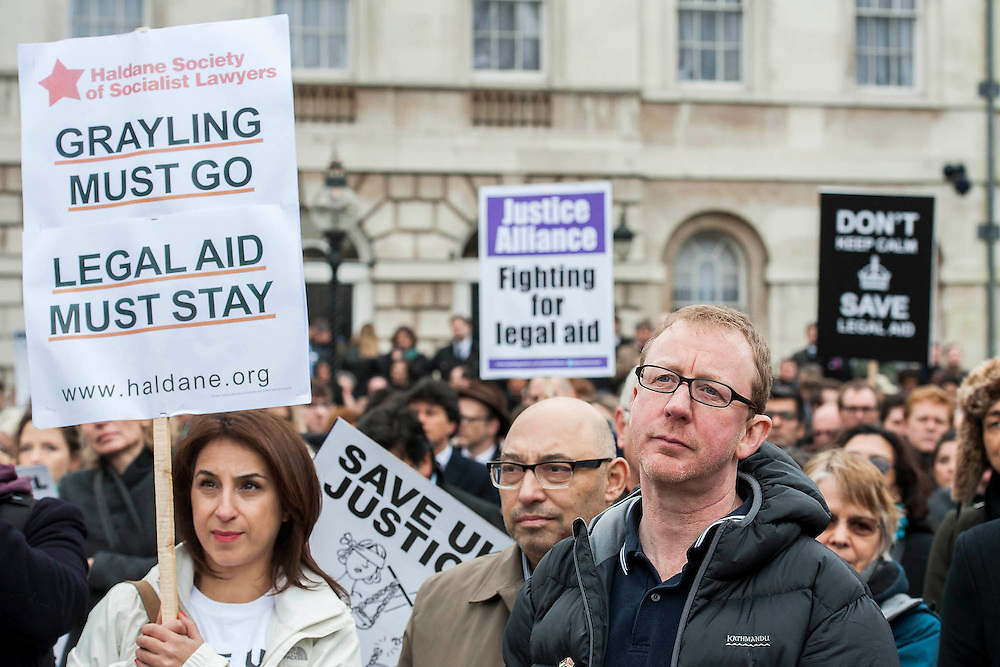 Hundreds of lawyers and barristers staged a protest at Westminster against legal aid cuts. They carried with them a huge effigy of Chris Grayling, the Justice Minister and were led by 'Justice' in a gold costume.<br /> <br /> Speakers included - Sadiq Khan is the Labour MP for Tooting and shadow minister for London, Shami Chakrabarti Director of Liberty, Blur drummer-turned-solicitor Dave Rowntree (pictured) and Paddy Hill, one of the Birmingham Six.  Houses of Parliament, Westminster, London, UK 07 March 2014.<br /> Guy Bell, 07771 786236, guy@gbphotos.com